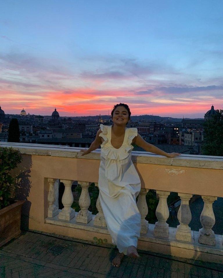 how to find Selena Gomez white frill neck maxi dress Italy July 2019 photo Selena Gomez