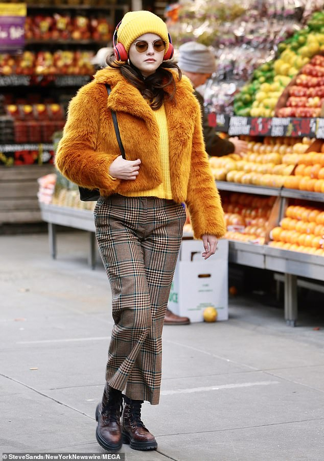 where to get Selena Gomez burnt orange faux fur jacket check trousers red hiking boots Only Murders In The Building 7 December 2020 Photo Steve Sands New york Newswire MEGA