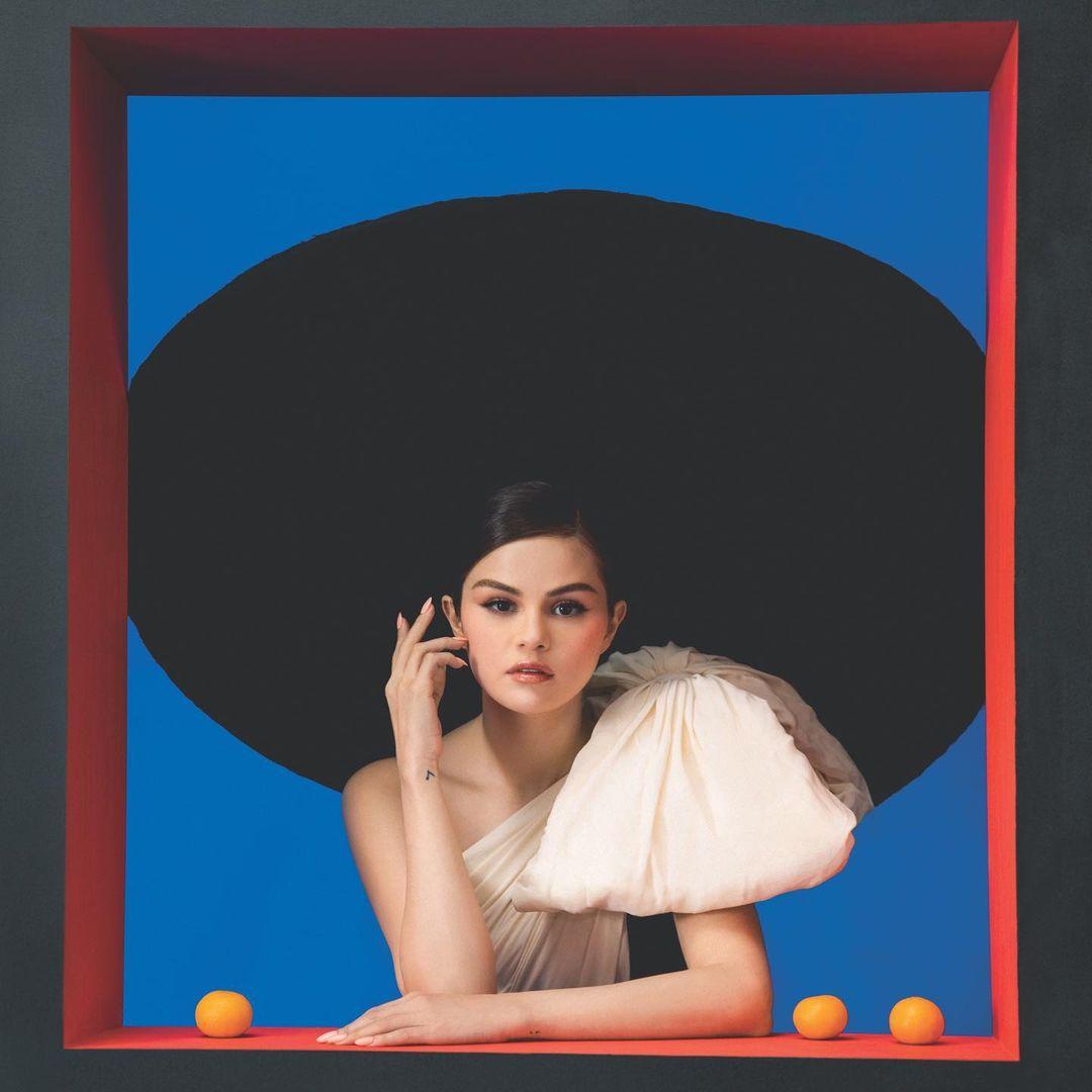 where to get Selena Gomez REVELACION black dress with bow shoulder January 2021 Photo Camila Falquez