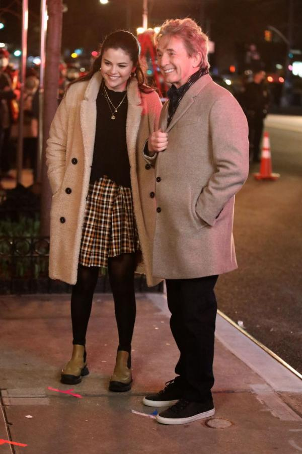 where to get Selena Gomez white yellow pleated check skirt green boots teddy coat MArch 31 2021 Photo Getty Images