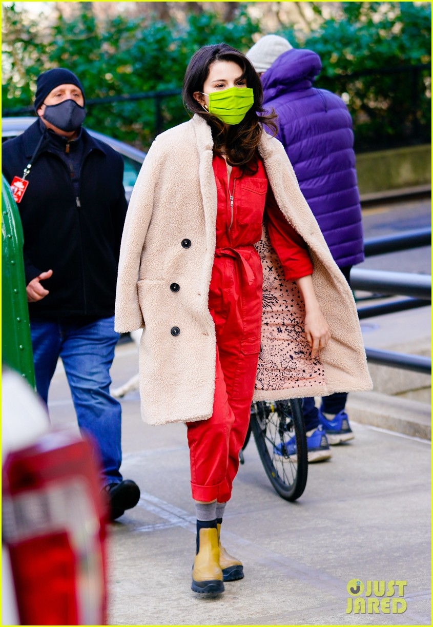 where to get Selena gomez red jumpsuit beige coat green chelsea boots Only Nurders In The Building Photo