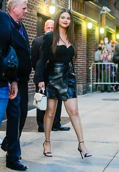 where to get Selena Gomez black leather mini skirt black body black sandals white bag The Late Show 7 September 2021 Photo Getty
