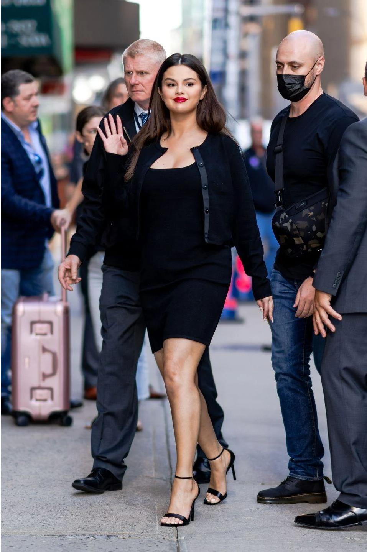 where to get Selena Gomez black rib dress black cardigan black sandals the Late Show 7 September 2021 Photo Gotham Getty Images