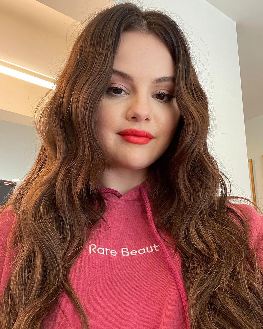 where to get Selena Gomez pink Rare Beauty Hoodie September 2021 Photo Rare Beauty